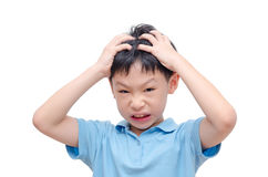 Boy scratching his scalp over white Stock Images
