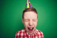 Boy screaming. Cute boy in birthday cap screaming Royalty Free Stock Photos