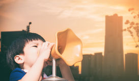 Boy screaming out megaphone Stock Images
