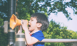 Boy is screaming out into Megaphone Stock Photos