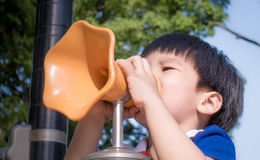 Boy is screaming into toy megaphone Royalty Free Stock Photos
