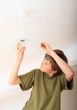 Boy screwing bulb Royalty Free Stock Image