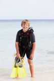 Boy With Scuba Diving Equipment Enjoying Beach Holiday Royalty Free Stock Photo