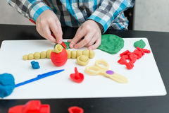 Boy sculpts from plasticine at home Royalty Free Stock Photo