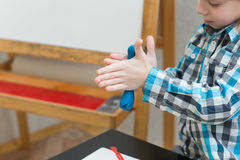 Boy sculpts from plasticine at home Royalty Free Stock Photography