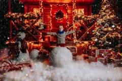Boy sculpts snowman stock photos