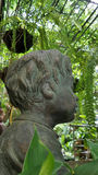 Boy sculpture in the garden Royalty Free Stock Photography