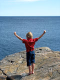 Boy at sea. 6-year old on top of the world Stock Photos