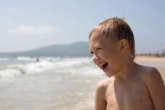 Boy and sea Stock Photos