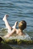 The boy on the sea stock photos