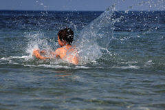 Boy in sea Royalty Free Stock Images