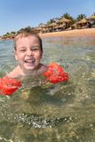 Boy in sea Stock Images