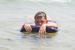 Boy at sea Stock Photos