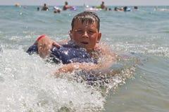 Boy at sea Stock Photography