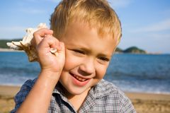 Boy & sea Stock Images