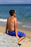 Boy on the sea Stock Photography