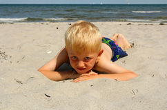 The boy on the sea beach Stock Photos