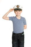 Boy in the sea cap salutes. Stock Images