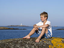 Boy at sea coast Stock Photography