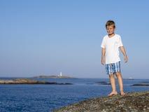 Boy at sea coast Stock Image