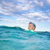 Boy in a sea Stock Photo