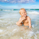 Boy in a sea Stock Photography