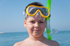 The boy on the sea with mask for diving Stock Photo