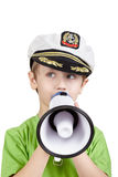 Boy in sea peaked cap says into megaphone Stock Images