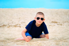 Boy sea sand glasses Royalty Free Stock Images