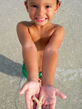 Boy with sea shell. Boy running and playing on st pete beachh in florida Stock Photo