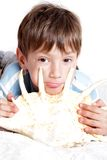Boy with sea shell over white Royalty Free Stock Images