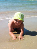 Boy on the sea shore Royalty Free Stock Photography