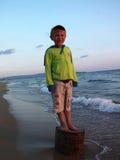 Boy on the sea shore Stock Photography