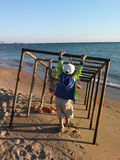Boy on the sea shore Stock Images