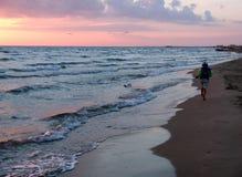 Boy on the sea shore Stock Photos
