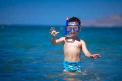 A boy in a sea with a swimming mask and snorkel Stock Image