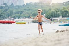 Boy on sea vacation royalty free stock images