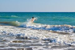 The boy in the sea wave surf. Kaifas beach, Greece Stock Photography