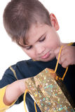 Boy searches for a gift. On a white background Royalty Free Stock Image