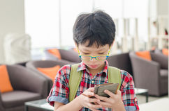 Boy searching map on smart phone Stock Photos