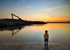 Boy at seaside enjoy his dusk time Royalty Free Stock Photos