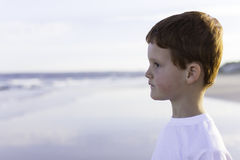 Boy seaside ocean looking waves Stock Photos
