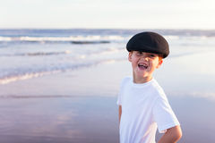 Boy seaside ocean waves Stock Image