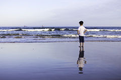 Boy seaside ocean waves Royalty Free Stock Image