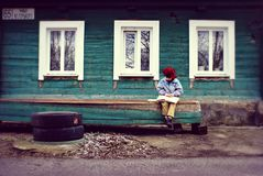 Boy Seating On Bench royalty free stock photo