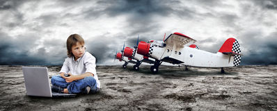 Boy seating with notebook Stock Photos