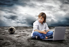 Boy seating with notebook Royalty Free Stock Photos