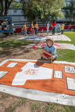 Boy with Section of AIDS Quilt Stock Images