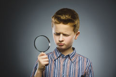 Boy See Through Magnifying Glass, Kid Eye Looking with Magnifier Lens over Gray Stock Images