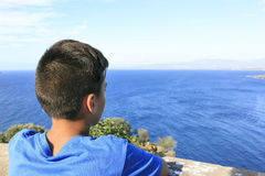 Boy seeing the blue sea Royalty Free Stock Photo